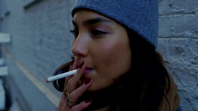 smoking in the winter - cigarette stock videos & royalty-free footage