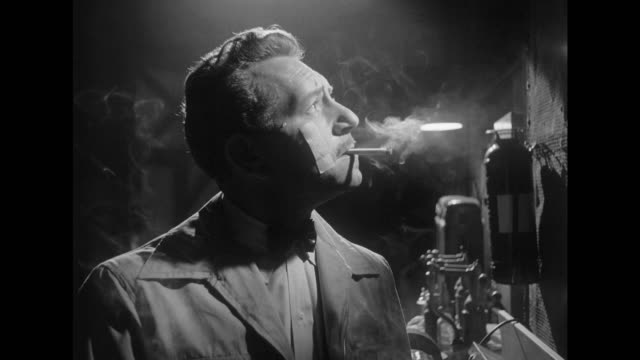 1948 smoking paul mechanic searches for heavy wrench while someone hums in the shadows - film noir style stock videos and b-roll footage