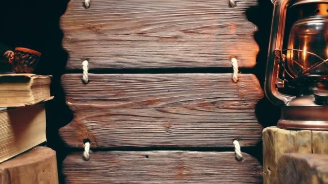 vidéos et rushes de pipe de tabagisme avec panneau en bois - kérosène