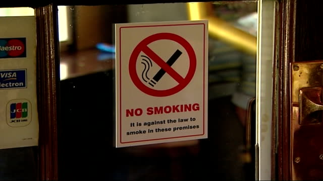 plans to ban cigarette displays in shops; t01070725 no smoking sign in pub - no smoking sign stock videos & royalty-free footage