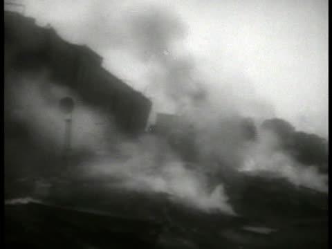 vídeos de stock e filmes b-roll de smoking train wrecked locomotive male walking through wreckage metal debris line group of people standing looking at something - 1935