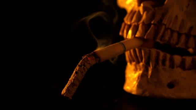 smoking untill dead.no smoking day concept. - skull stock videos & royalty-free footage
