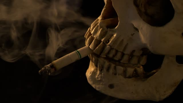 smoking untill dead.no smoking day concept. - tobacco product stock videos & royalty-free footage