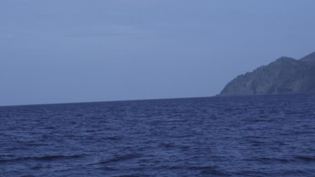 smoking volcano filmed from sea, day,  barren island, andaman islands, march 2011 - andaman sea stock videos & royalty-free footage
