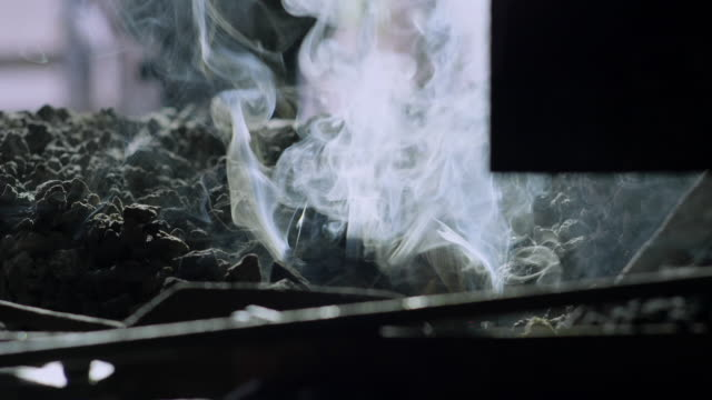 a smoky fire crackles in a blacksmithing workshop. - coal stock videos & royalty-free footage