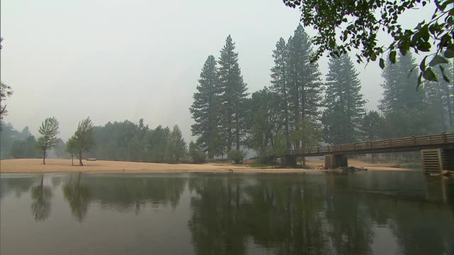 smoky landscape inside of yosemite national park in california on july 26, 2018. the park was closed to guests due to air quality conditions from... - yosemite national park stock videos & royalty-free footage