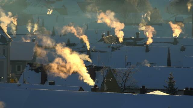 Smoky smokestacks in winter, Nesselwang, Svabia, Bavaria, Germany
