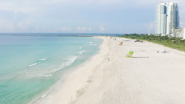 smooth around high drone movement over miami beach lifeguard in south beach, miami, florida at sunset. - アールデコ地区点の映像素材/bロール