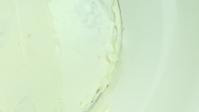 Smooth butter cream on side of the cake. Top view