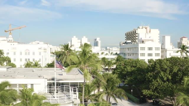 smooth high drone movement over ocean drive in south beach, miami, florida at early morning, usa - オーシャンドライブ点の映像素材/bロール
