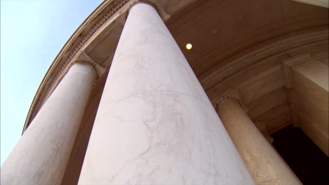 Smooth pillars hold up the Jefferson Memorial in Washington, D.C.