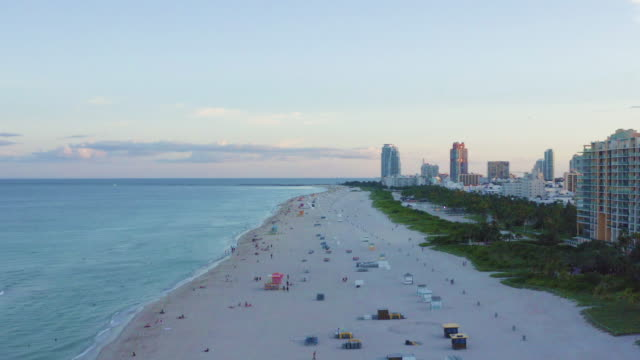 smooth travelling forward high drone movement over miami south beach, florida at sunset - アールデコ地区点の映像素材/bロール