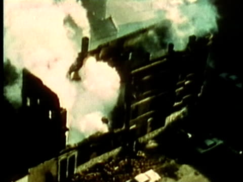 Smouldering buildings and rubble on city streets following race riots/ USA