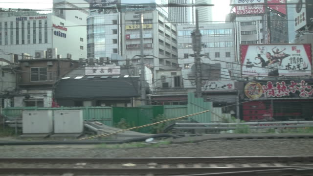 sm,side pov shot of tokyo.japan - banner sign stock videos & royalty-free footage