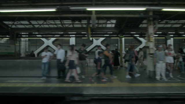 sm,side pov shot of tokyo.japan - railway station platform stock videos & royalty-free footage