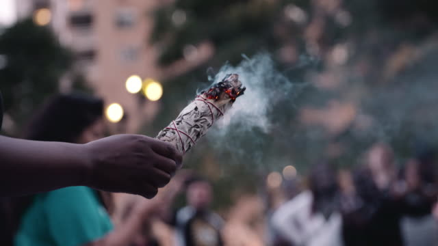 smudge stick smoking in busy urban scene. - native american ethnicity stock videos & royalty-free footage