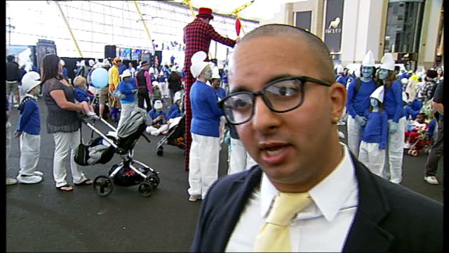 'smurfs' set new world record at the o2 arena vin sharma interview sot vox pop - world record stock videos and b-roll footage