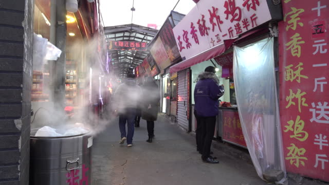 a snack street beside yantai university gathering street snacks from around china the food street called yanda snack street though shabby is very... - chinese food stock videos & royalty-free footage