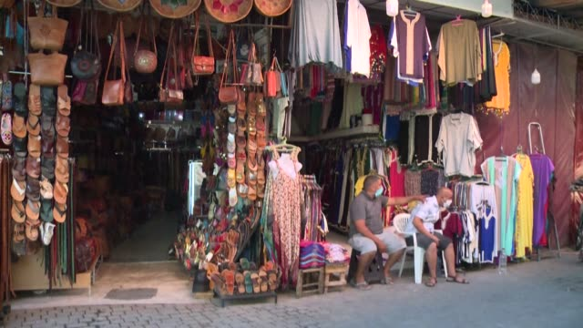 snake charmers, storytellers and crowds of tourists; the legendary jamaa el fna square of morocco's marrakech is almost as famous for the number of... - storyteller stock videos & royalty-free footage