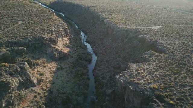 snaking river in ravine far below in midst of california wilderness - ravine stock videos & royalty-free footage