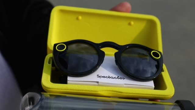 snapchat spectacles by snap inc being held and worn at 701 ocean front walk in the venice neighborhood of los angeles california us on tuesday march... - スナップチャット点の映像素材/bロール
