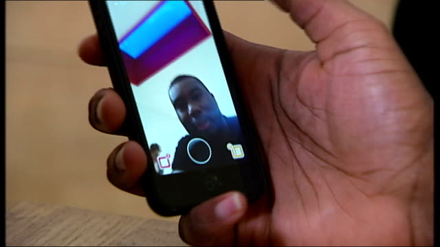 snapchat to make its app more secure following security breach london int reporter sitting with peigh asante and derrick obaretin close shot of... - スナップチャット点の映像素材/bロール