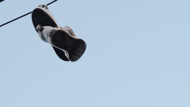 Sneakers hanging on a power line