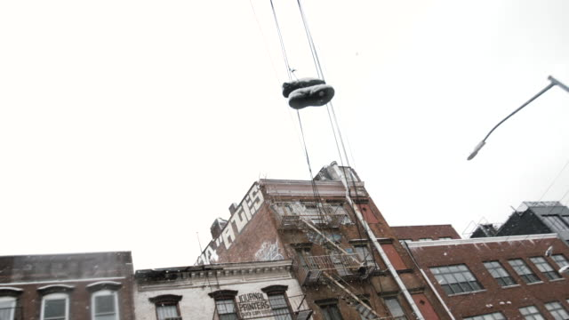 sneakers hanging on a telephone line - telephone line stock videos and b-roll footage