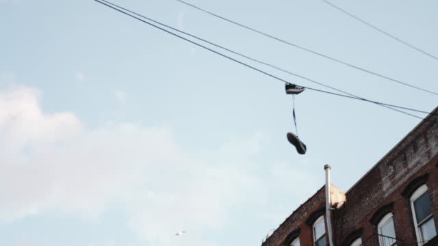 sneakers hanging on power lines - telephone line stock videos and b-roll footage