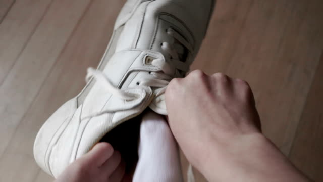 sneakers on - tie stock videos and b-roll footage
