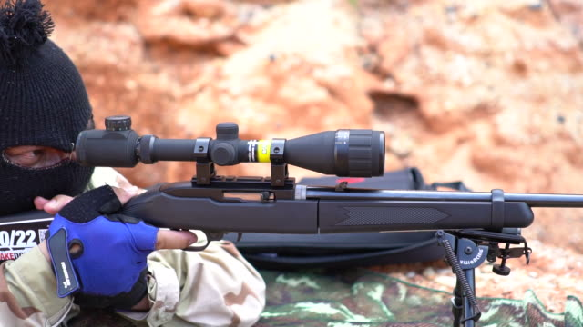 sniper corrects optical sight and makes the shot - rifle stock videos & royalty-free footage