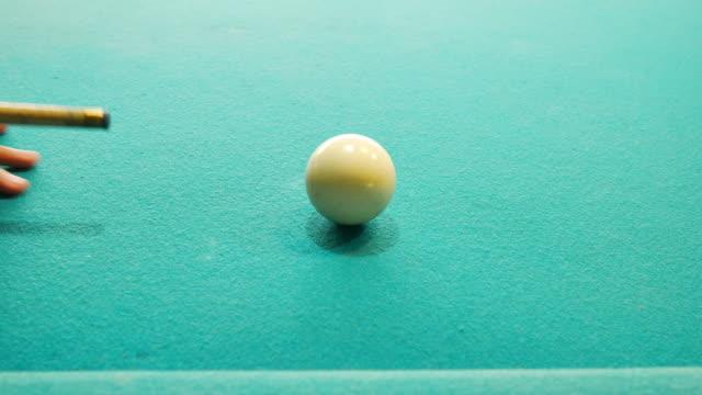 snooker player shoot white ball