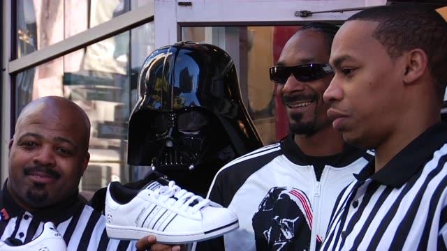 Snoop Dogg and Darth Vader at the Snoop Dogg Stormtroopers Launch Adidas Originals X Star Wars Collection at New York NY