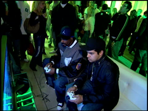 snoop dogg and wilmer valderrama play xbox at the launch party for xbox's next generation console xbox 360 at a private residence in beverly hills... - wilmer valderrama stock videos and b-roll footage