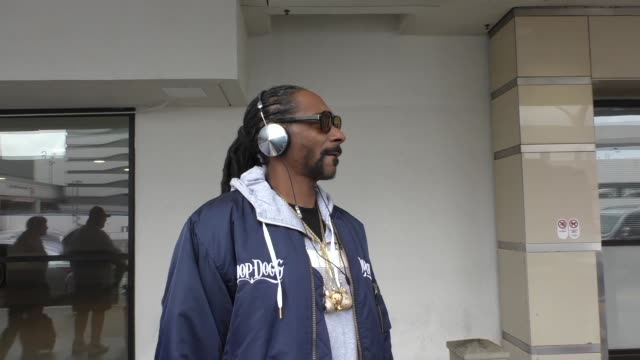 snoop dogg talks about if sam hunt can get a hood pass at lax airport in los angeles in celebrity sightings in los angeles, - snoop dogg stock videos & royalty-free footage