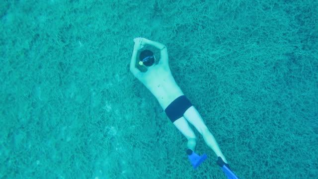 Snorkel diver enjoying the sea bottom