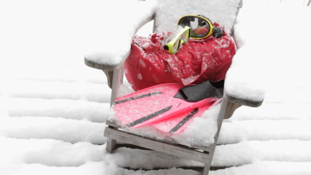 snorkel gear on snow covered andirondack chair - adirondack chair stock videos & royalty-free footage