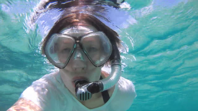 snorkel selfie - t shirt stock videos and b-roll footage