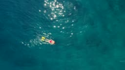 Snorkeling in clear turquoise sea