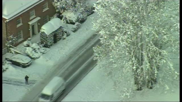 berkshire, buckinghamshire and surrey; traffic along thru snow, residential area in snow / slow-moving traffic along icy road thru village /... - aldershot stock videos & royalty-free footage