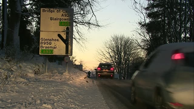 snow and flooding forecast for much of country perthshire gv village buildings in snow cars along snowy road country lane in snow car along snowy... - perthshire stock videos & royalty-free footage
