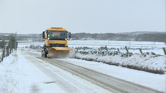 snow and ice affect parts of the uk scotland aberdeenshire ext snow plough along snow covered road - aberdeenshire stock videos & royalty-free footage