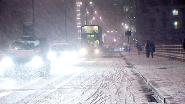 Snow and ice cause travel disruption across the UK London Traffic towards over bridge including bus in snow storm