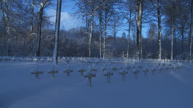 snow and shadows cover crosses in a cemetery. - cemetery stock videos & royalty-free footage