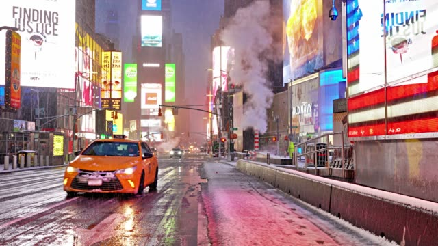 snow at times square - taxi stock videos & royalty-free footage