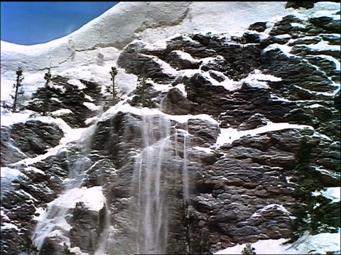 snow avalanche on rocky mountain / seven brides for seven brothers (1954) - 1954 stock-videos und b-roll-filmmaterial