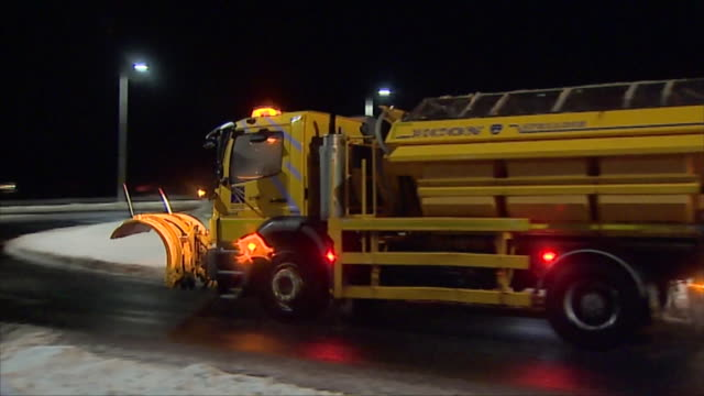 snow being cleared from roads by a maintenance vehicle - snow vehicle stock videos and b-roll footage