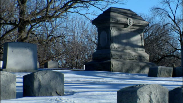 snow blankets a cemetery. - cemetery stock videos & royalty-free footage