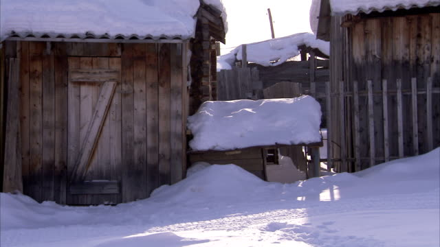 Snow blankets a remote Siberian village. Available in HD