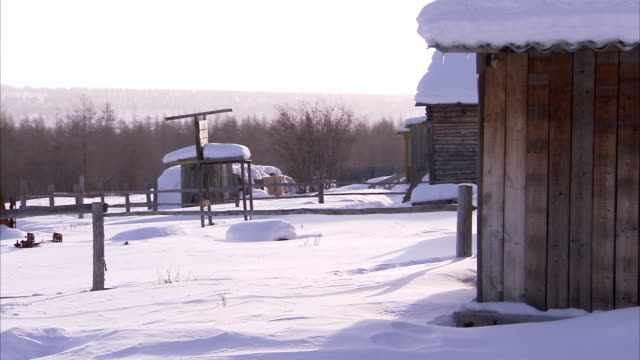 snow blankets a remote siberian village. available in hd - remote location stock videos & royalty-free footage